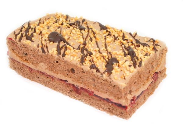 Ciasto orzechowe - ciasto biszkoptowo-tłuszczowe z dodatkiem orzechów włoskich wykończone kremem orzechowym i marmoladą